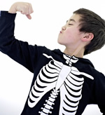 Young Boy in Skeleton Costume